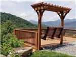 View larger image of A swinging bench seat overlooking the valley at MAMA GERTIES HIDEAWAY CAMPGROUND image #1