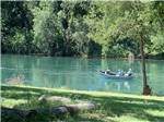 View larger image of Three people in a boat fishing at JGW RV PARK image #3