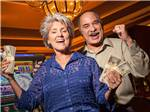 View larger image of A woman holding a wad of cash at LAKESIDE CASINO  RV PARK image #5