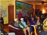 View larger image of A group of people sitting around inside at BLACK CANYON RANCH RV RESORT image #5