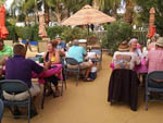 View larger image of People sitting around outside at BLACK CANYON RANCH RV RESORT image #10