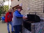 View larger image of A man barbecuing meat at BLACK CANYON RANCH RV RESORT image #12
