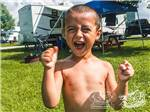 View larger image of Young boy excited to be camping at CABOOSE LAKE CAMPGROUND image #4