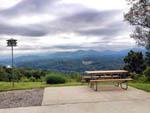 View larger image of Picnic table with beautiful view at CAMPFIRE LODGINGS image #4