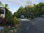 View larger image of One of the many paved RV sites at CAMPFIRE LODGINGS image #6