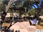 View larger image of Seating area with picnic table at RANCHEROS DE SANTA FE CAMPGROUND image #8