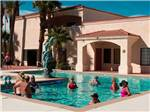 View larger image of People in swimming pool at DESERT SKIES RV RESORT image #2