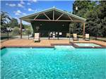 View larger image of Swimming pool and chaise lounges at FERNBROOK PARK image #2