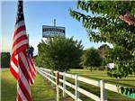 View larger image of USA flag and sign at front of park at FERNBROOK PARK image #6