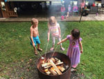 View larger image of Kids roasting marshmallows at YOGI BEARS JELLYSTONE PARK OF PIGEON FORGEGATLINBURG image #3