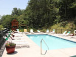 View larger image of Swimming pool with outdoor seating at YOGI BEARS JELLYSTONE PARK OF PIGEON FORGEGATLINBURG image #4