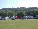 View larger image of RVs and trailers parked among trees and near mountain at SOUTHGATE RV PARK OF FAYETTEVILLE image #3