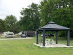 View larger image of Grey patio seating area RVs and SUVs at SOUTHGATE RV PARK OF FAYETTEVILLE image #4