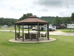 View larger image of Brown circle patio area with seating at SOUTHGATE RV PARK OF FAYETTEVILLE image #6