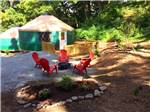 View larger image of Five adirondack chairs around campfire at CIRCLE M CAMPING RESORT image #5