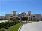 View larger image of Front of casino building with world shaped statue at FUN TOWN RV PARK AT WINSTAR image #7