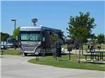 View larger image of RVs parked in gravel pull-thru at FUN TOWN RV PARK AT WINSTAR image #8