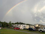 View larger image of Rainbow over a row of RVs at CATHEAD CREEK RV PARK image #2