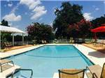 View larger image of Swimming pool with outdoor seating at RED GATE CAMPGROUND  RV PARK image #3