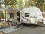 View larger image of Couple relaxing at their campsite at DRIFTWOOD RV RESORT  CAMPGROUND image #8