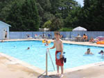 View larger image of Kids swimming in pool at TALL PINES CAMPGROUND RESORT image #4