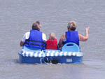 View larger image of Family boating on the lake at 370 LAKESIDE PARK RV CAMPGROUND image #5