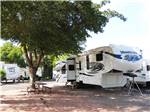 View larger image of Trailer with picnic table camping at campsite at THOUSAND TRAILS LAS VEGAS RV RESORT image #6