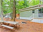 View larger image of Cabins with decks and picnic tables at MOODY BEACH RV CAMPGROUND image #3