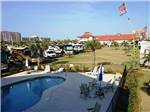 View larger image of Aerial view over campground and ocean at PENSACOLA BEACH RV RESORT image #3