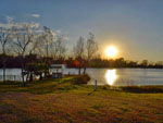 View larger image of Lake view at sunset at HIDDEN LAKE RV PARK image #4