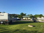 View larger image of Trailer camping at campsite at HIDDEN LAKE RV PARK image #6
