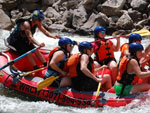 View larger image of Family rafting with guide at WIND RIVER CASINO image #6