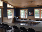 View larger image of Dining area at lodge at CAMP N CLASS RV PARK image #11