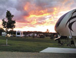 View larger image of Campgrounds at sunset at CAMP TURKEYVILLE RV RESORT image #9