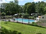 View larger image of The fenced in pool area at WHISPERING PINES CAMPING ESTATES image #1