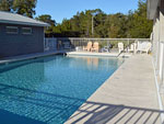 View larger image of Swimming pool with outdoor seating at CEDAR KEY RV RESORT image #5