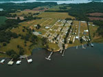 View larger image of Aerial view from water at WINDEMERE COVE RV RESORT image #9