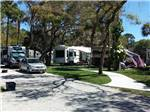 View larger image of RV parked in tree shaded sites at SEMINOLE CAMPGROUND image #2