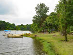 View larger image of Boats docked on the lake at LONG LAKE RESORT  RV PARK image #6