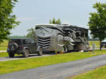 View larger image of Trailer camping at campsite at LONG LAKE RESORT  RV PARK image #9