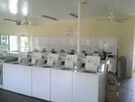 View larger image of Laundry room with washer and dryers at GULF WATERS RV RESORT image #6