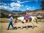 View larger image of Girl on a horse at RANCHO OSO RV  CAMPING RESORT image #6