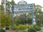 View larger image of Sign of the park entrance at WHISPERING PINES RV PARK image #1