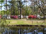 View larger image of View of RVs near the water at WHISPERING PINES RV PARK image #4