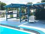View larger image of Shaded area at pool at SUNSEEKERS RV PARK image #4