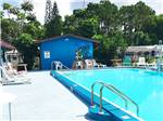 View larger image of Swimming pool with outdoor seating at SUNSEEKERS RV PARK image #5