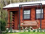 View larger image of Log cabin with swing set in front at HIDDEN PARADISE CAMPGROUND image #4