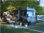 View larger image of Couple camping in RV at RIO VERDE RV PARK image #1