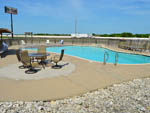 View larger image of Swimming pool with outdoor seating at I 35 RV PARK  RESORT image #1