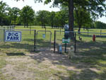 View larger image of Black gated dog park with red hydrant toy at I 35 RV PARK  RESORT image #4